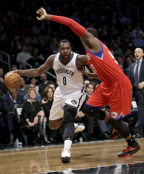 Brooklyn Nets' Andray Blatche, left, tries to move past Philadelphia 76ers' Lavoy Allen during the first half of an NBA basketball game at the Barclays Center, Monday, Dec. 16, 2013, in New York.  (AP Photo/Seth Wenig)
