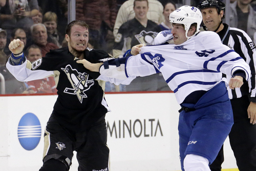 Pittsburgh Penguins' Zach Sill, left, fights with Toronto Maple Leafs' Troy Bodie (40) in the second period of an NHL hockey game in Pittsburgh, Monday, Dec. 16, 2013. The Penguins won 3-1. (AP Photo/Gene J. Puskar)