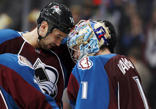 Colorado Avalanche left wing Patrick Bordeleau, left, congratulates goalie Semyon Varlamov, of Russia, after the Avalanche's 6-2 victory over the Dallas Stars in an NHL hockey game in Denver on Monday, Dec. 16, 2013. (AP Photo/David Zalubowski)