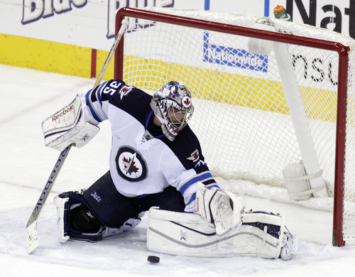 Winnipeg Jets' Al Montoya makes a save against the Columbus Blue Jackets during the third period of an NHL hockey game Monday, Dec. 16, 2013, in Columbus, Ohio. The Jets won 3-2. (AP Photo/Jay LaPrete)