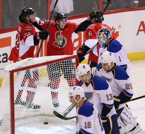 Ottawa Senators Jean- Gabriel Pageau (44) celebrates his goal during with teammates Erik Condra (22) and Robby Ryan (6) as St. Louis Blues goaltender Brian Elliot (1) and teammates Derek Roy (12) Carlo Colaiacovo (13) and Chrsi Stewrat (25) look on during first period NHL hockey action in Ottawa Monday, Dec. 16, 2013. (AP Photo/The Canadian Press, Fred Chartrand)