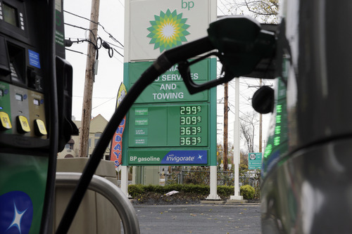 A sign at a BP filling station says regular gas is $2.99, per gallon in Lakewood, N.J., Tuesday, Nov. 12, 2013. Prices for regular gas at several gas stations in the area have dropped below $3.00-a-gallon. (AP Photo/Mel Evans)