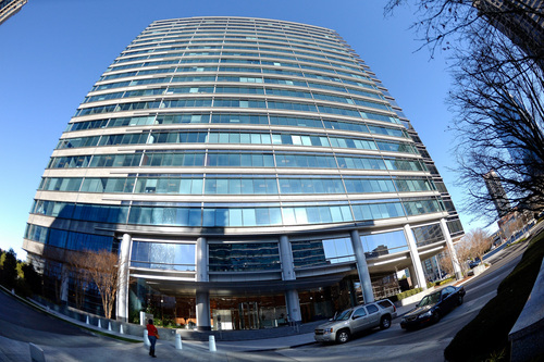 This photo taken with a fisheye lens shows an entrance to the Alliance Center office building in Atlanta, on  Wednesday, Dec. 18, 2013, where a small newsstand sold one of two winning Mega Millions lottery tickets from Tuesday's near-record $636 million drawing, according to lottery officials. (AP Photo/David Tulis)