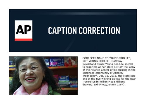 CORRECTS NAME TO YOUNG SOO LEE, NOT YOUNG SOOLEE - Gateway Newsstand owner Young Soo Lee speaks to reporters at her store just off the lobby of the Alliance Center office building in the Buckhead community of Atlanta, Wednesday, Dec. 18, 2013. Her store sold one of the two winning tickets for the near-record $636 million Mega Millions drawing. (AP Photo/Johnny Clark)