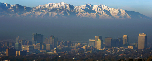 Steve Griffin  |  The Salt Lake Tribune   The sunrise illuminates the peaks of the Oquirrh Mountains as a the inversion blankets the Salt Lake Valley in Salt Lake City, Utah Monday, December 16, 2013.