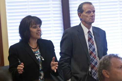 Chris Detrick  |  The Salt Lake Tribune House Speaker Becky Lockhart, R-Provo, talks as House Majority Leader Brad Dee, R-Ogden, listens about the possibility of impeaching Attorney General John Swallow in the Utah House Republican caucus room Wednesday June 19, 2013.