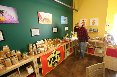 Francisco Kjolseth  |  The Salt Lake Tribune Artist Rudy Kovacs, who uses honey wax in his work, stops in to The Honey Stop at 159 E. 800 South in Salt Lake City, which carries many Utah brands of raw honey that haven't been heated or adulterated.