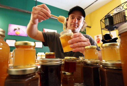 Francisco Kjolseth  |  The Salt Lake Tribune Peter Somers, owner of The Honey Stop at 159 E. 800 South in Salt Lake City, sells several Utah brands of raw honey that haven't been heated or adulterated. Christmas is one of the most popular times to buy honey, both as gifts and for baking.