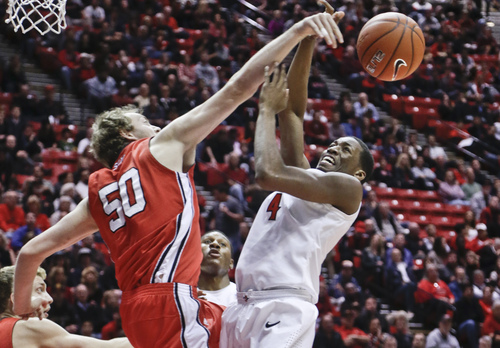 San Diego State guard Dakarai Allen is fouled by Southern Utah center Jayson Cheesman while driving to the basket during the first half of an NCAA college basketball game Wednesday, Dec. 18, 2013, in San Diego. (AP Photo/Lenny Ignelzi)