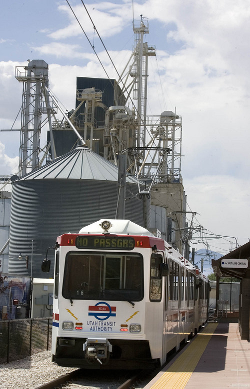 Paul Fraughton  |   Tribune file photo A Utah Transit Authority Trax train rolls past grain storage in this photo from 2013.
