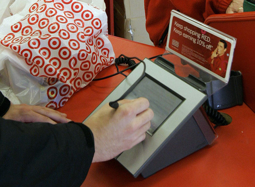 FILE - In this Jan. 18, 2008 file photo, a customer signs his credit card receipt at a Target store in Tallahassee, Fla. Target says that about 40 million credit and debit card accounts customers may have been affected by a data breach that occurred at its U.S. stores between Nov. 27, 2013, and Dec. 15, 2013. (AP Photo/Phil Coale, File)