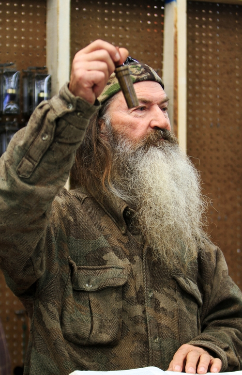 """File-This Nov. 7, 2013 file photo shows Phil Robertson, the Duck Commander, holding the 1 millionth duck call assembled for 2013 at company's warehouse in West Monroe, La. The A&E channel says """"Duck Dynasty"""" patriarch Robertson is off the show indefinitely after condemning gays as sinners in a magazine interview. In a statement Wednesday,  Dec. 18, 2013, A&E said it was extremely disappointed to read Robertson's comments in GQ magazine. (AP Photo, The News-Star/Margaret Croft)     NO SALES"""