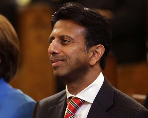 """Louisiana Gov. Bobby Jindal attends a funeral Mass for artist George Rodrigue, at St. Louis Cathedral in New Orleans, Thursday, Dec. 19, 2013. """"Duck Dynasty"""" patriarch Phil Robertson - suspended from the series indefinitely after making disparaging remarks about gays - is getting some support from key followers, including Jindal. He lamented the suspension on free speech terms. """"It's a messed-up situation when Miley Cyrus gets a laugh, and Phil Robertson gets suspended,"""" he said in a statement Thursday. The show is filmed in his state. (AP Photo/Gerald Herbert)"""