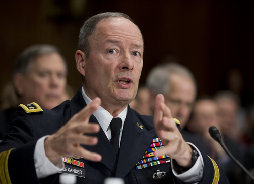 "National Security Agency (NSA) Director Gen. Keith Alexander testifies on Capitol Hill in Washington, Wednesday, Dec. 11, 2013, before the Senate Judiciary Committee hearing on ""Continued Oversight of U.S. Government Surveillance Authorities"" .      (AP Photo/Manuel Balce Ceneta)"