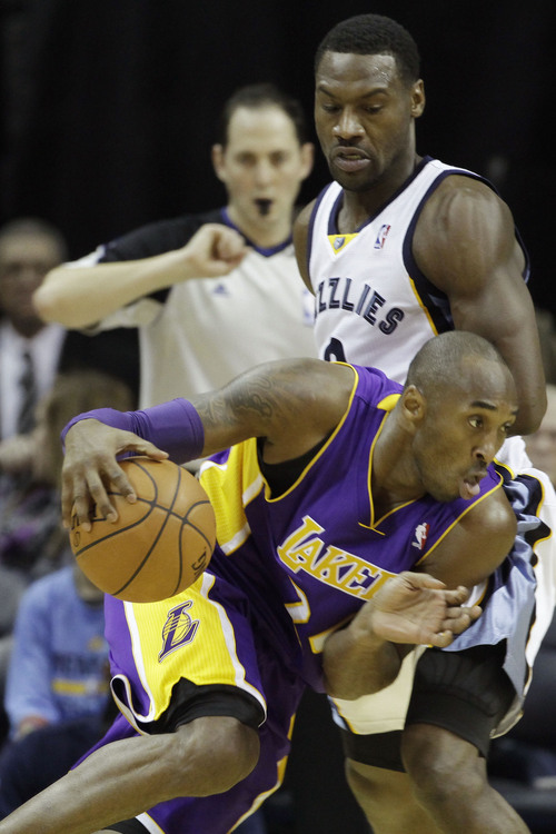 cheap for discount cacbe b9426 Los Angeles Lakers  Kobe Bryant, bottom, works the ball against Memphis  Grizzlies