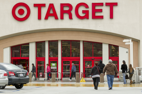 Shoppers arrive at a Target store in Los Angeles on Thursday, Dec. 19, 2013. Target says that about 40 million credit and debit card accounts may have been affected by a data breach that occurred just as the holiday shopping season shifted into high gear. (AP Photo/Damian Dovarganes)