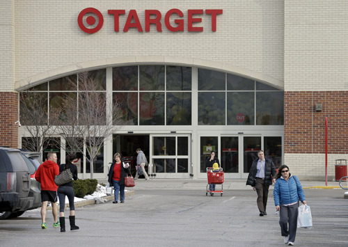 Shoppers leave a Target store in North Olmsted, Ohio Thursday, Dec. 19, 2013. Target says that about 40 million credit and debit card accounts may have been affected by a data breach that occurred just as the holiday shopping season shifted into high gear. (AP Photo/Mark Duncan)