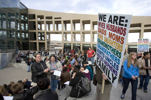 Paul Fraughton  |   Salt Lake Tribune People gather at the amphitheater at Library Square for a vigil in support of gay marriage on March 25, 2013. Judge Robert J. Shelby ruled on Dec. 20 that Utah's ban on same-sex marriage is unconstitutional. The man on the right is unidentified.