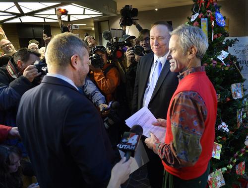 Scott Sommerdorf   |  The Salt Lake Tribune Utah State Senator Jim Dabakis, center, is married to Stephen Justesen by Salt Lake City Mayor Ralph Becker, right, at the Salt Lake County offices, Friday December 20, 2013.