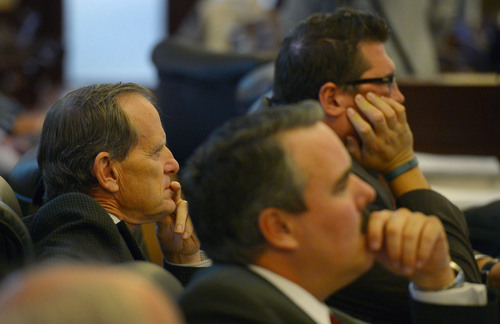 Steve Griffin     The Salt Lake Tribune   House Majority Leader Brad Dee, R-Ogden, left, watches and listens, with fellow representatives Francis Gibson, right, and Lee Perry, center,  to a recording of John Swallow and Jeremy Johnson talking during a meeting at a restaurant in Orem. The House Special Investigative Committee presented its findings for alleged misconduct by former Attorney General John Swallow at the Capitol in Salt Lake City, Utah Thursday, December 19, 2013.