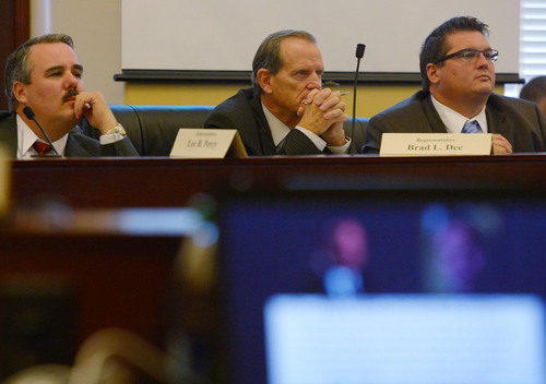 Steve Griffin     The Salt Lake Tribune   House Majority Leader Brad Dee, R-Ogden, center, watches and listens, with fellow representatives Francis Gibson, right, and Lee Perry, left,  to a recording of John Swallow and Jeremy Johnson talking during a meeting at a restaurant in Orem. The House Special Investigative Committee presented its findings for alleged misconduct by former Attorney General John Swallow at the Capitol in Salt Lake City, Utah Thursday, December 19, 2013.