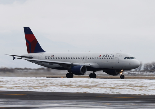 A Delta plane takes-off at the Provo Airport on December 19, 2013 in Provo, Utah. Several Delta flight were diverted and landed at the Provo Airport after the Salt Lake City a Airport was closed standing several hundred passengers.  (Photo by George Frey     Special to the Tribune)