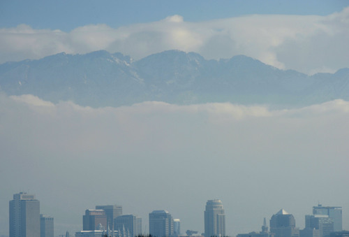 Steve Griffin     The Salt Lake Tribune  The snow-covered Wasatch Mountains peek out from the cloud cover over Salt Lake City Friday, Dec. 20, 2013.