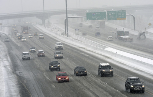 Al Hartmann     The Salt Lake Tribune  Traffic moves slowly along I-15 at 2700 South during the heavy wet snow falling Thursday Dec. 19, 2013.
