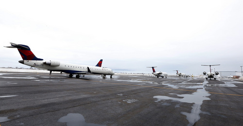 Several Delta planes sit on the ground at the Provo Airport on December 19, 2013 in Provo, Utah. Several Delta flight were diverted and landed at the Provo Airport after the Salt Lake City a Airport was closed standing several hundred passengers.  (Photo by George Frey     Special to the Tribune)