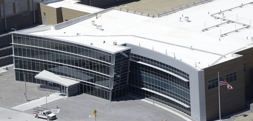 This June 6, 2013, photo, shows an aerial view of the NSA's Utah Data Center in Bluffdale, Utah. The nation's new billion-dollar epicenter for fighting global cyberthreats sits just south of Salt Lake City, tucked away on a National Guard base at the foot of snow-capped mountains. The long, squat buildings span 1.5 million square feet, and are filled with super-powered computers designed to store massive amounts of information gathered secretly from phone calls and emails. (AP Photo/Rick Bowmer)