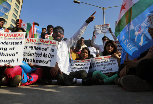 """Members of the National Students Union of India (NSUI), the student wing of India's ruling Congress party, shout slogans during a protest outside the U.S. consulate in Mumbai, India, Friday, Dec. 20, 2013. India's Information Minister Manish Tewari lashed out at the United States on Friday and demanded an apology for the treatment and arrest of Devyani Khobragade, India's deputy consul general in New York, saying America cannot behave """"atrociously"""" and get away with it. (AP Photo/Rafiq Maqbool)"""