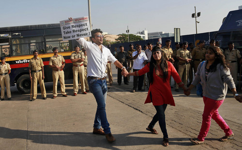 """Members of the National Students Union of India (NSUI), the student wing of India's ruling Congress party, participate in a protest outside the U.S. consulate in Mumbai, India, Friday, Dec. 20, 2013. India's Information Minister Manish Tewari lashed out at the United States on Friday and demanded an apology for the treatment and arrest of Devyani Khobragade, India's deputy consul general in New York, saying America cannot behave """"atrociously"""" and get away with it. (AP Photo/Rafiq Maqbool)"""