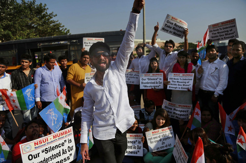 """A member of the National Students Union of India (NSUI), the student wing of India's ruling Congress party, shouts slogans during a protest outside the U.S. consulate in Mumbai, India, Friday, Dec. 20, 2013. India's information minister Manish Tewari lashed out at the United States on Friday and demanded an apology for the treatment and arrest of Devyani Khobragade, India's deputy consul general in New York, saying America cannot behave """"atrociously"""" and get away with it. (AP Photo/Rafiq Maqbool)"""