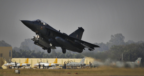 India's indigenously designed and developed combat aircraft Tejas takes off during its air display at Hindustan Aeronautics Limited airport in Bangalore, India, Friday, Dec. 20, 2013. Tejas, a single engine, single seat, supersonic, multirole light combat aircraft got Initial Operational Clearance (IOC II) Friday a milestone towards its induction into Indian Air Force for operations. (AP Photo/Aijaz Rahi)