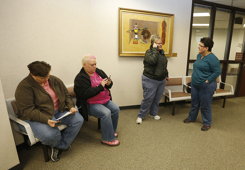 Patsy Carter left, Raylynn Marvel, 2nd left, from Orem, Utah,  2nd right, and Arlene Arnold 2nd right, Loreen Major right, from Lehi, Utah try and decide what to do outside the offices of the Utah County Clerk and Auditor office after they were rejected for a marriage license  as a lesbian couple on Dec. 20, 2013 in Provo, Utah. A federal Judge on Friday struck down Utah's ban on same sex marriage saying the law violates the U.S. Constitution.  (Photo by George Frey  |  Special to the Tribune)