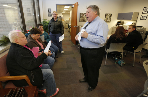 Utah County Clerk and Auditor Bryan Thompson hands out rejection letters for a marriage license to Raylynn Marvel left, Patsy Carter, 2nd left, from Orem, Utah, Loreen Major 2nd right, and Arlene Arnold right, from Lehi, Utah in the offices of the Utah County Clerk and Auditor office on Dec. 20, 2013 in Provo, Utah. A federal Judge on Friday struck down Utah's ban on same sex marriage saying the law violates the U.S. Constitution.  (Photo by George Frey  |  Special to the Tribune)