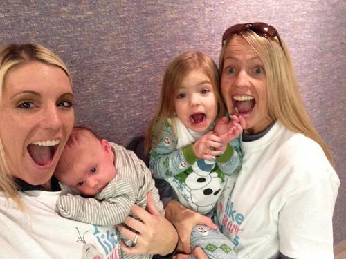 | Courtesy photo  Jo and Lindi Barney, seen holding their daughters Tyce anad Kylen, were married Friday after a federal judge struck down Utah's constitutional amendment and laws preventing same-sex marriage.