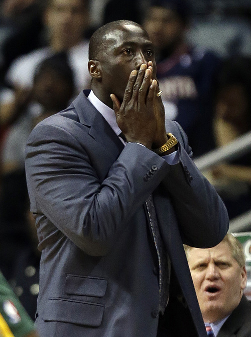 Utah Jazz head coach Tyrone Corbin reacts after his team was called for a foul in the first half of an NBA basketball game against the Atlanta Hawks, Friday, Dec. 20, 2013, in Atlanta. (AP Photo/John Bazemore)
