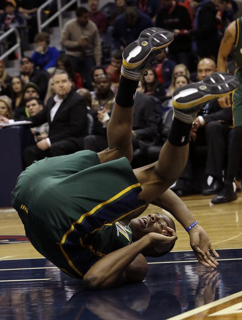 Utah Jazz point guard Alec Burks falls while chasing a loose ball in the first half of an NBA basketball game against the Atlanta Hawks, Friday, Dec. 20, 2013, in Atlanta. (AP Photo/John Bazemore)
