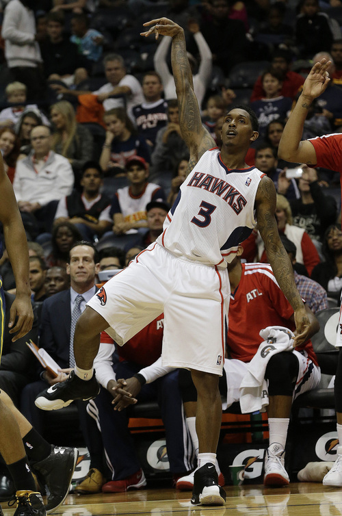 Atlanta Hawks shooting guard Louis Williams (3) follows through with a three-point basket in the second half of an NBA basketball game against the Utah Jazz, 2Friday, Dec. 20, 2013, in Atlanta.  (AP Photo/John Bazemore)