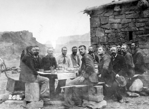 Photo Courtesy Utah State Historical Society  Stanton Survey crew eating Christmas dinner in 1889  in front of the Lee's Ferry fort.