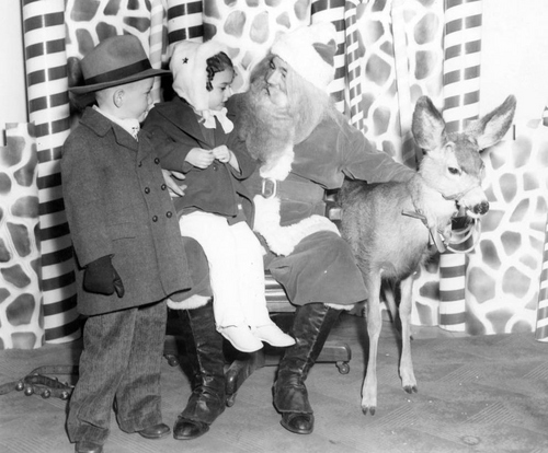 Photo Courtesy Utah State Historical Society  Santa Claus with children and a deer, Dec. 24, 1945.