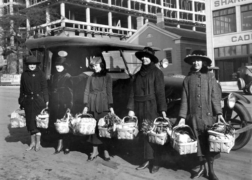 Photo Courtesy Utah State Historical Society  Image shows Mountain States girls with Christmas gift baskets, December 24, 1918.