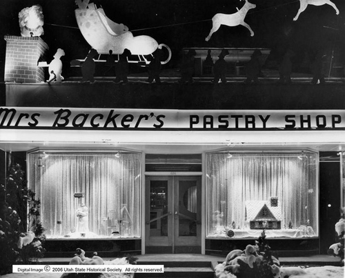 Photo Courtesy Utah State Historical Society  Christmas window displays at Mrs. Bacher's Pastry Shop in Salt Lake City in 1947.