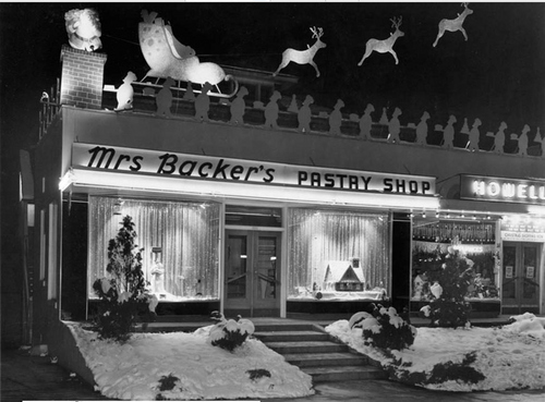 Photo Courtesy Utah State Historical Society  Christmas window displays at Mrs. Bacher's Pastry Shop in Salt Lake City.