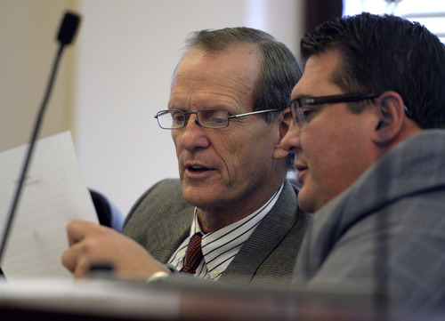 Rick Egan  | The Salt Lake Tribune   Rep. Brad Dee (left) and Rep. Francis GIbson read over documents as the House Special Investigative Committee reports on its findings in the John Swallow probe at the Utah State Capitol, Friday, December 20, 2013.