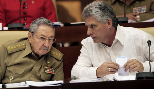 Cuba's President Raul Castro, left, and Vice President Miguel Diaz-Canel attend the opening of a twice-annual legislative sessions, at the National Assembly in Havana, Cuba, Friday, Dec. 20, 2013. (AP Photo/Cubadebate, Ismael Francisco)
