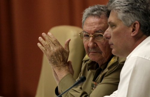 Cuba's President Raul Castro, left, and Vice President Miguel Diaz-Canel attend the closing of the of a twice-annual legislative sessions, at the National Assembly in Havana, Cuba, Saturday, Dec. 21, 2013. (AP Photo/Ismael Francisco, Cubadebate)
