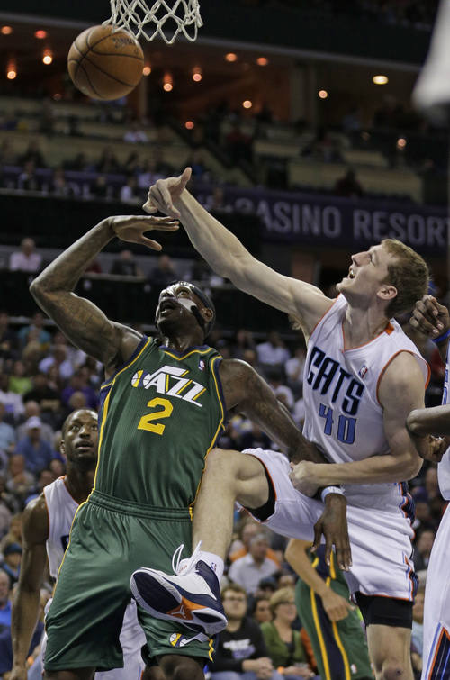 Utah Jazz's Marvin Williams (2) is fouled by Charlotte Bobcats' Cody Zeller (40) during the first half of an NBA basketball game in Charlotte, N.C., Saturday, Dec. 21, 2013. (AP Photo/Chuck Burton)