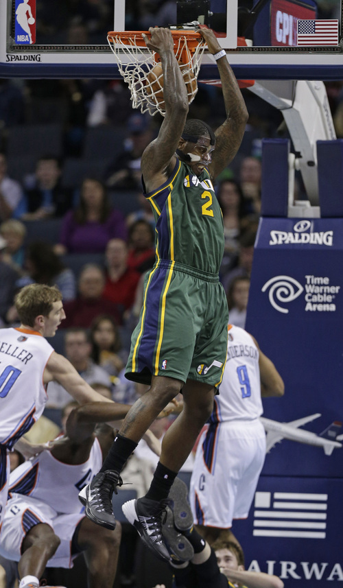 Utah Jazz's Marvin Williams (2) dunks against the Charlotte Bobcats during the second half of an NBA basketball game in Charlotte, N.C., Saturday, Dec. 21, 2013. The Jazz won 88-85. (AP Photo/Chuck Burton)